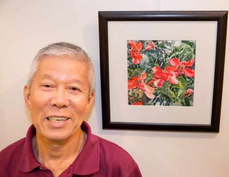 "Wan Lee with ""Morning Prayer."" You can see the placement of this watercolor in the photo on the right."