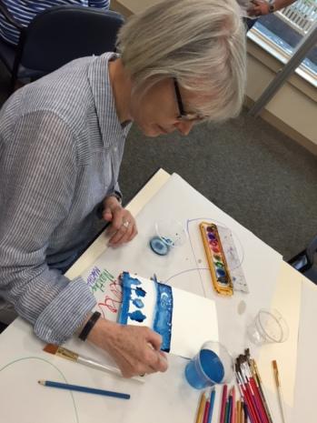 Martha Pope creates her greeting card.