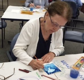 Marian Wiseman works on her greeting card