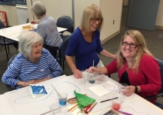 Artist Valerie Watson (center) enjoys a moment participants