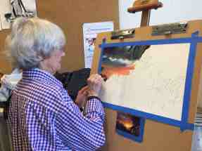 Anne Shields. Getting started on a pastel of a sunset in Costa Rica.